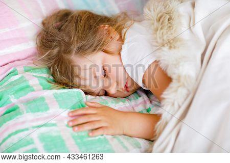 Cute Little Toddler Girl Sleeping In Bed. Tired Preschool Child Dreaming, Healthy Sleep Of Children