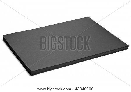 a pile of black cardstocks on a white background