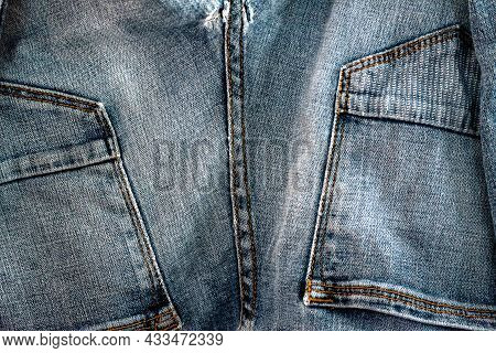 Old Worn Jeans Texture. Highly Detailed Closeup Of Blue Jeans. Cool Background