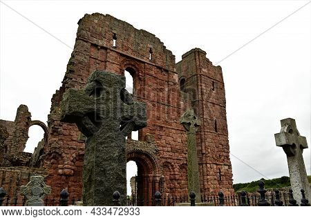 An External View Of The Ruins Of A Medieval Priory Building On The Island Of Lindisfarne In Northumb