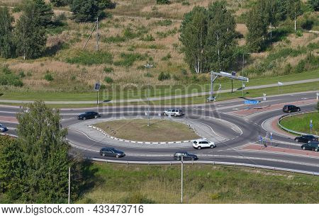 Top View Of Rural Roundabout With Traffic. Roundabout Traffic Of Cars On The Circle Ring Road Aerial