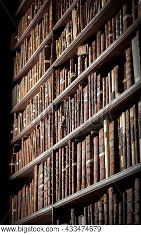 Vintage Library With Shelves Of Old Books In The Long Room In The Trinity College. Dublin, Ireland -
