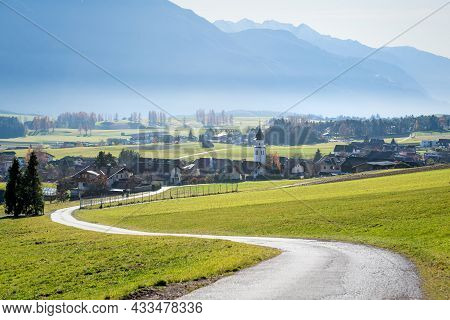 Road To Sunny Austrian Mountain Village With Foggy Valley Background In Autumn, Wildermieming, Tirol