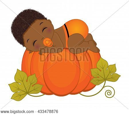 Cute Little Black Baby Boy Wearing Orange Sleeping On Pumpkin. Baby Boy Is Curly With Pacifier. Litt