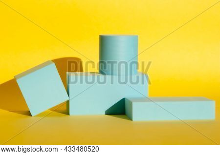 Minimalist Abstract Background. Three-dimensional Geometric Podiums For Goods On Yellow Background.