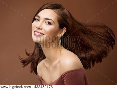 Smiling Brunette Beauty Woman With Straight Hair Flying In Air. Happy Young Girl With Perfect Smile