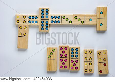 Top View Of Wooden Dominoes Gaming Pieces On The White Background