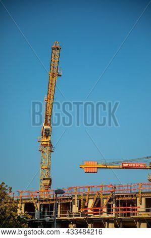Prague, Czech Republic - 04.09.2021: New Modern Residential Building Contruction Work With Crane Aro