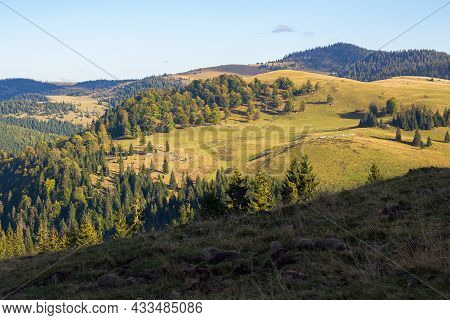 Apuseni Natural Park Of Romania. Landscape With Forested Rolling Hills And Valleys In Evenign Light.