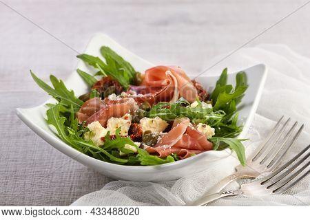 Arugula Salad, Prosciutto With Sun-dried Tomatoes, Slices Of Mozzarella, Capers, Seasoned With Olive