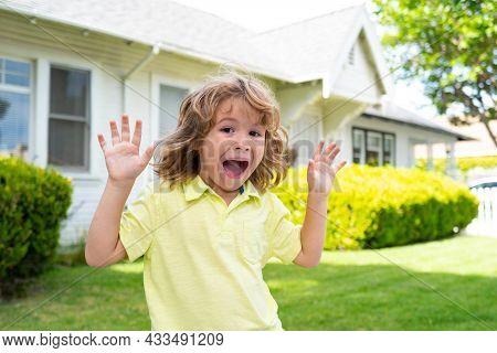 Kids Funny Face Having Fun Outdoors. Happy Child Having Fun On Backyard Outdoors.