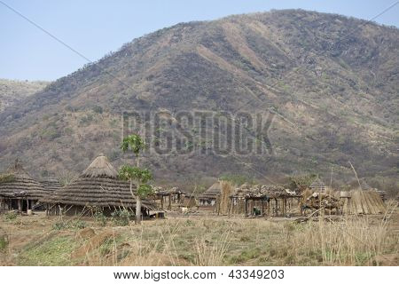remote village in south sudan with mountains