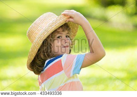 Head Shot Of Summer Child In Straw Hat. Kids Face, Little Boy Portrait.