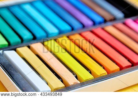 Bright Colorful New Crayons Or Chalk Pastels In A Box Close-up. Selective Focus. Close-up.