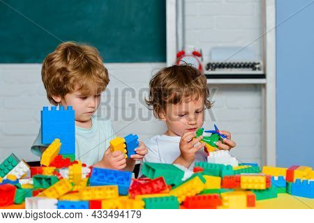 Little Toddler Boys Playing With Toy Constructors. Toy Mess In Child Room. Educational Games For Kid