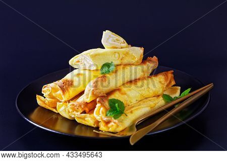 Blintz, Rolled Filled With Sweetened Cottage Cheese Pancakes Or Crepes On A Plate