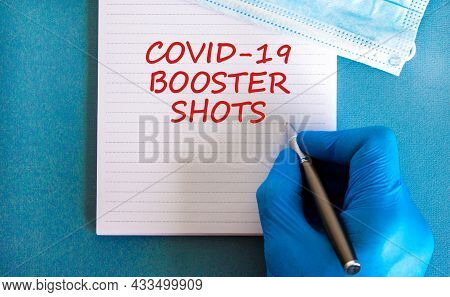 Covid-19 Booster Shots Vaccine Symbol. White Note With Words Covid-19 Booster Shots, Beautiful Blue