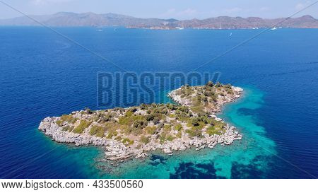 Aerial View Of Island And Cliffs In Mediterranean Sea Or Aegean Sea With Deep Blue Color Water. Turq