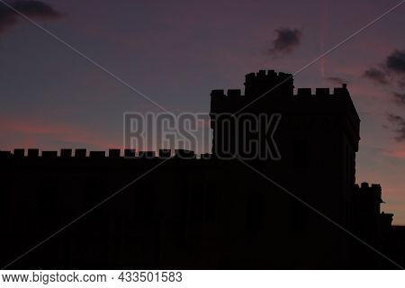 Silhouette Of The Tower Of Lednice Castle At Sunset. The Castle Was Inscribed On The Unesco List In