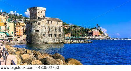 Beautiful italian coastal town Rapallo. View of medieval fortress and beach. Italy, Liguria summer holidays