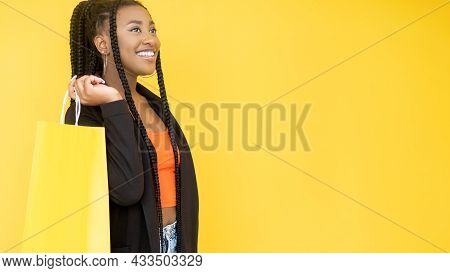 Big Sale. Offer Banner. Black Friday. Satisfied Afro Woman Shopaholic With Shopping Paper Bag Isolat