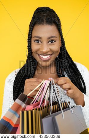 Woman Shopaholic. Shopping Sale. Black Friday. Happy Smiling African Lady Holding Many Store Paper B