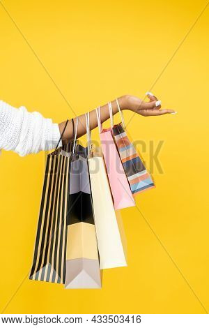 Shopaholic Lifestyle. Sale Offer. Holiday Shopping. Closeup Of African Woman Hand With Purchase Bags