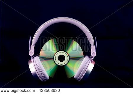 Cd And Headphones Isolated On A Blue Background