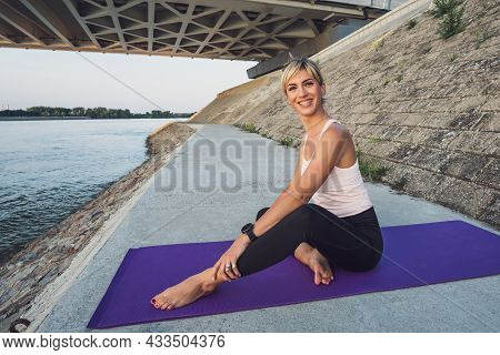 Young Woman Is Ready For Outdoor Exercise.