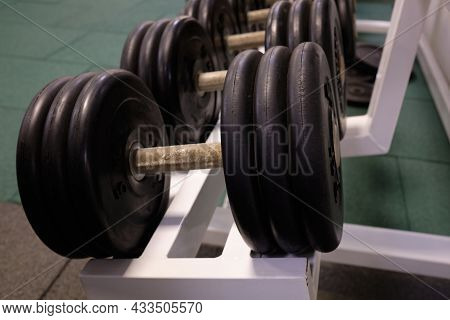Heavy Dumbbells In The Gym. Sports Dumbbells In In A Rack In Sports Club.