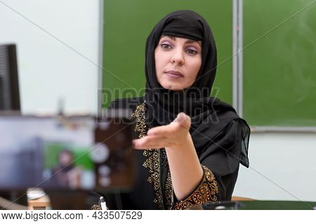A Muslim Teacher Is Broadcasting A Lesson Online During The Pandemic, Waiting For The Student's Resp
