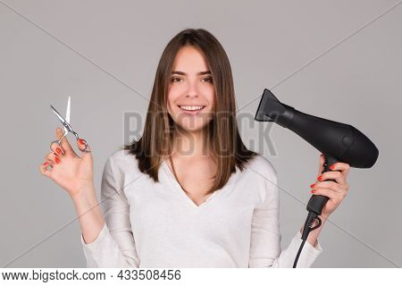Woman With Hair Dryer And Scissors. Beautiful Girl With Straight Hair Drying Hair With Professional