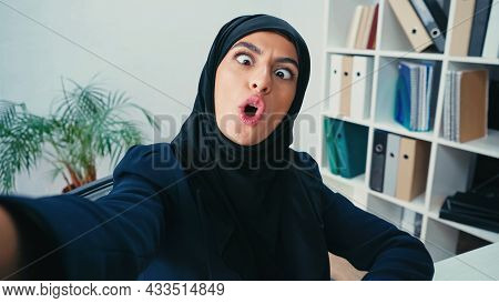Young Muslim Businesswoman Grimacing While Taking Selfie