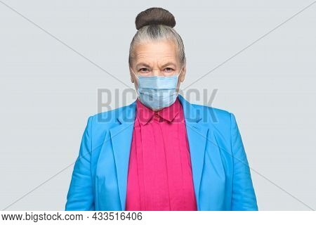 Protection Against Contagious Disease, Coronavirus. Aged Woman With Hygienic Mask To Prevent Infecti