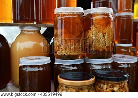 Jars Of Organic, Natural Honey On The Counter For Sale. Different Honey, Different Colors In Glass J