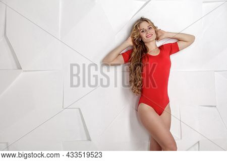 Satisfied Beautiful Sexy Girl In Red Bodysuit With Long Curly Blonde Hairstyle And Makeup, Perfect B