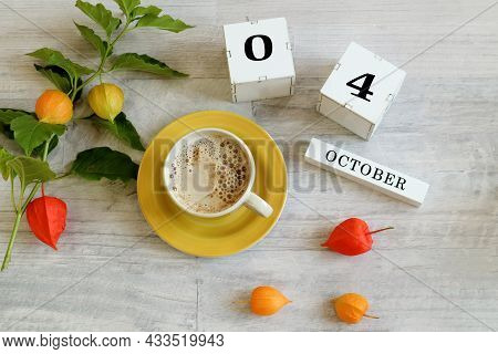 Calendar For October 4 : The Name Of The Month In English, Cubes With The Numbers 0 And 4, A Yellow