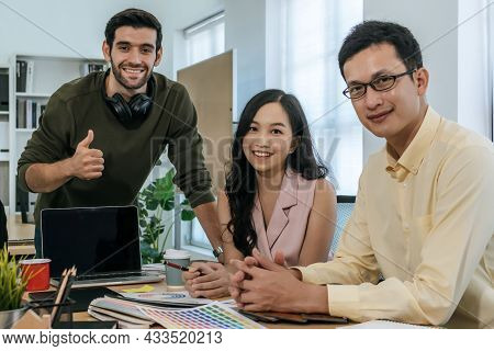 Group Of Colleagues Young Business People In Smart Casual Looking At Camera Working And Planning New