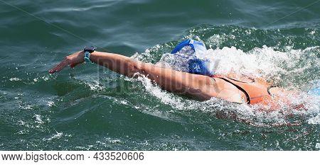 Woman Swimmer Swimming Crawl In Blue Sea, Race For Triathlon