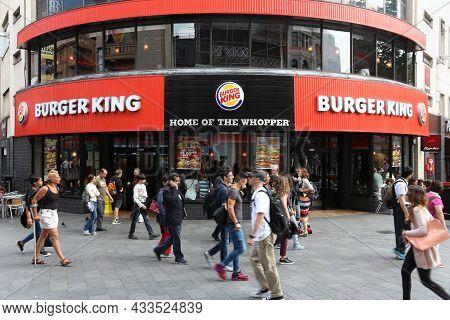 London, Uk - July 6, 2016: People Walk By Burger King Restaurant In London, Uk. Burger King Has 16,8