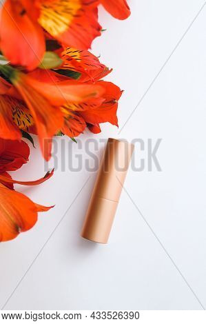 Atomizer In A Golden Case And Red Alstroemeria On A White Background - Flatley