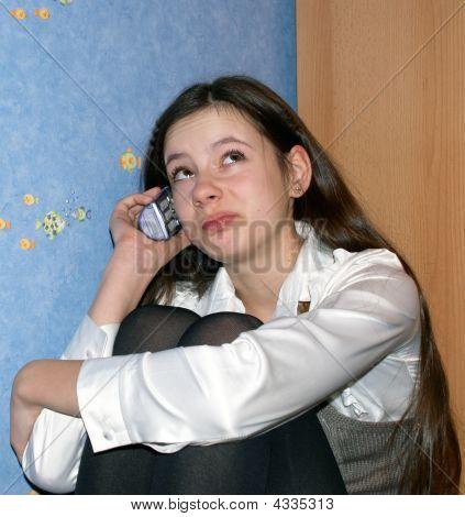Teen Girl Talking On A Phone