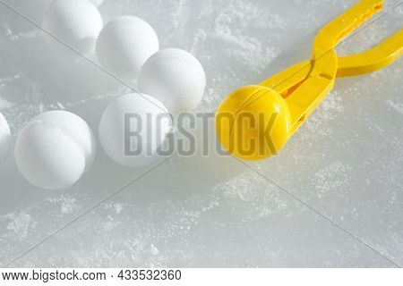 A Tool For Modeling And Making Snowballs From Snow For Children's Winter Games. Snowballs Lying On T