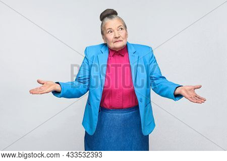 Puzzled Or Confused Old Woman. Emotion And Feelings Handsome Expressive Grandmother With Light Blue