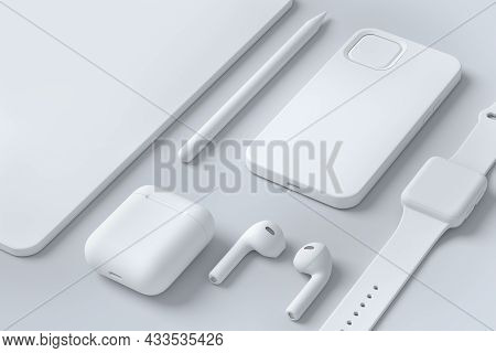 Monochrome Computer Tablet With Stylus, Smart Watch And Headphones On White