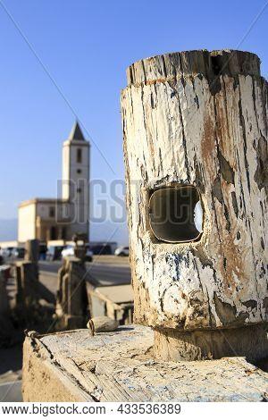 Wooden Tie Point At Las Salinas Beach In Cabo De Gata-nijar Natural Park. Beautiful Church In The Ba
