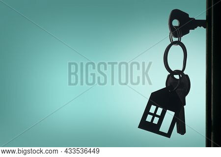 Silhouette Of The Keys With House Keyring In The Door Keyhole With Copy Space Background