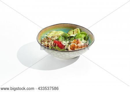 Healthy food - poke bowl with prawn, rice, fresh vegetables, edamame beans, soybean sprouts . Traditional dish Hawaiian cuisine. Poke bowl with shrimp isolated on white background.