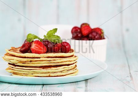 Homemade Pancakes And Fresh Berries. Pancakes With Strawberries And Cherries.