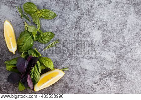 Selection Of Herbs And Spices On Stone Background. Rosemary, Basil And Lemon With Copy Space. Top Vi